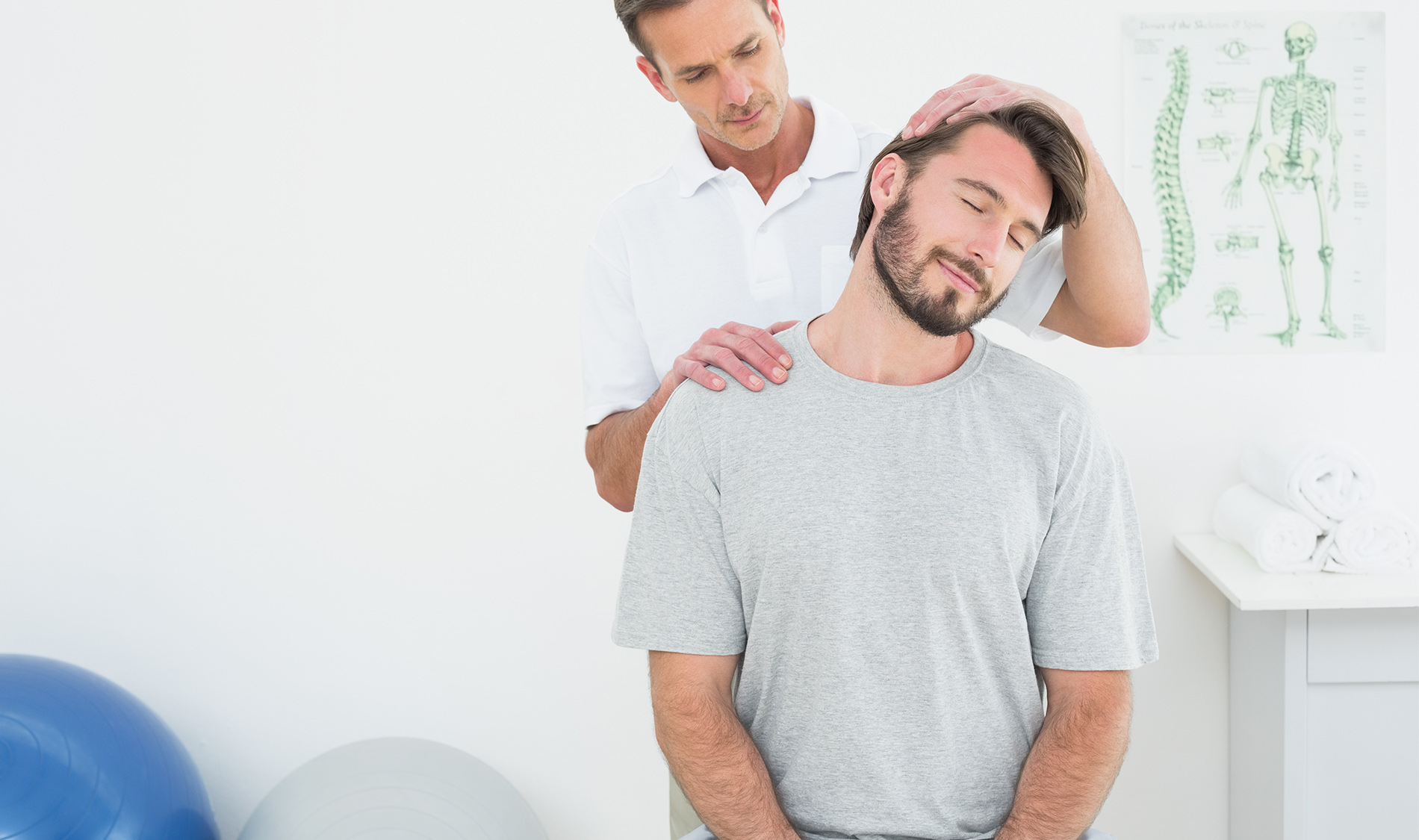 chiropractor adjusting patients spine